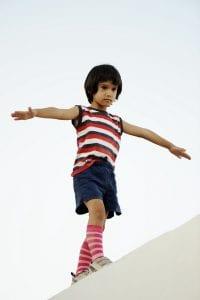 Child balancing on ledge